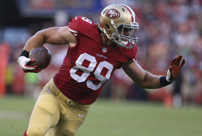 Aug 25, 2013; San Francisco, CA, USA; San Francisco 49ers tight end Vance McDonald (89) runs after receiving the ball against the Minnesota Vikings during the third quarter at Candlestick Park. The San Francisco 49ers defeated the Minnesota Vikings 34-14. Mandatory Credit: Kelley L Cox-USA TODAY Sports
