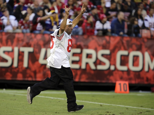 Aug 25, 2013; San Francisco, CA, USA; A San Francisco 49ers fan rushes the field during the fourth quarter against the Minnesota Vikings at Candlestick Park. The San Francisco 49ers defeated the Minnesota Vikings 34-14. Mandatory Credit: Kelley L Cox-USA TODAY Sports