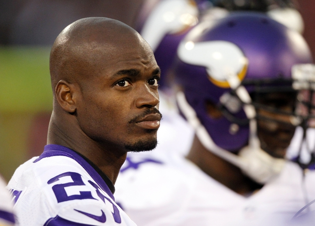 Aug 25, 2013; San Francisco, CA, USA; Minnesota Vikings running back Adrian Peterson (28) stands on the sideline against the San Francisco 49ers in the fourth quarter at Candlestick Park. The 49ers defeated the Vikings 34-14. Mandatory Credit: Cary Edmondson-USA TODAY Sports