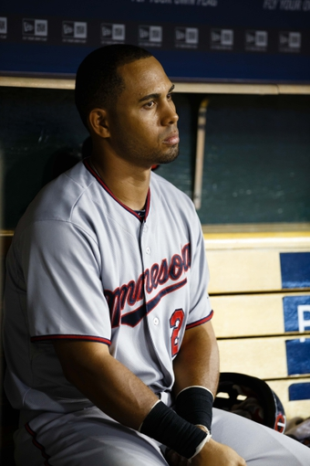 Aug 21, 2013; Detroit, MI, USA; Minnesota Twins left fielder Wilkin Ramirez (22) sits in dugout during the eighth inning against the Detroit Tigers at Comerica Park. Mandatory Credit: Rick Osentoski-USA TODAY Sports