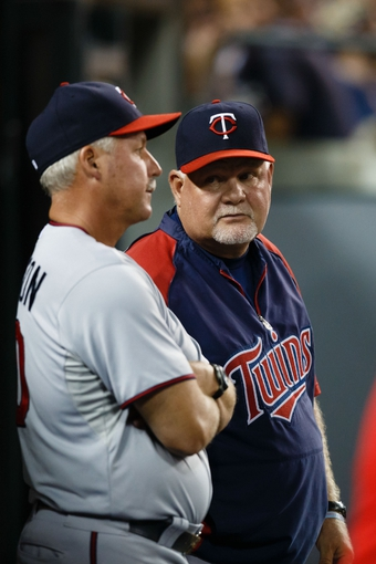 Aug 21, 2013; Detroit, MI, USA; Minnesota Twins manager Ron Gardenhire (35) talks to pitching coach Rick Anderson (40) against the Detroit Tigers at Comerica Park. Mandatory Credit: Rick Osentoski-USA TODAY Sports