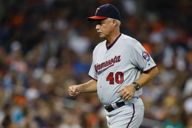 Aug 21, 2013; Detroit, MI, USA; Minnesota Twins pitching coach Rick Anderson (40) walks off the field against the Detroit Tigers at Comerica Park. Mandatory Credit: Rick Osentoski-USA TODAY Sports