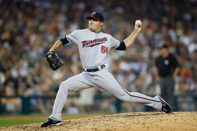 Aug 21, 2013; Detroit, MI, USA; Minnesota Twins relief pitcher Caleb Thielbar (56) pitches against the Detroit Tigers at Comerica Park. Mandatory Credit: Rick Osentoski-USA TODAY Sports