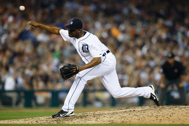 Aug 21, 2013; Detroit, MI, USA; Detroit Tigers relief pitcher Jose Veras (31) pitches in the eighth inning against the Minnesota Twins at Comerica Park. Mandatory Credit: Rick Osentoski-USA TODAY Sports