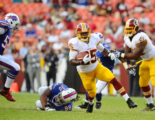 Aug 24, 2013; Landover, MD, USA; Washington Redskins running back Keiland Williams (25) rushes the ball against the Buffalo Bills during the second half at FedEX Field. Mandatory Credit: Brad Mills-USA TODAY Sports