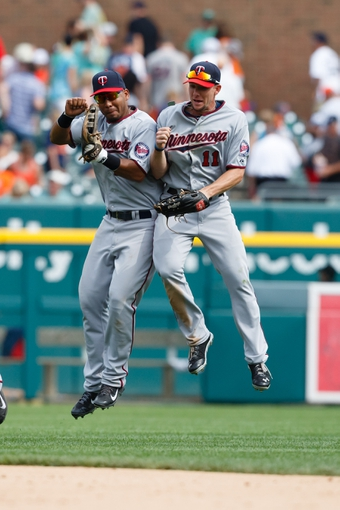 Aug 22, 2013; Detroit, MI, USA; Minnesota Twins left fielder Wilkin Ramirez (22) and center fielder Clete Thomas (11) celebrate after the game against the Detroit Tigers at Comerica Park. Minnesota won 7-6. Mandatory Credit: Rick Osentoski-USA TODAY Sports