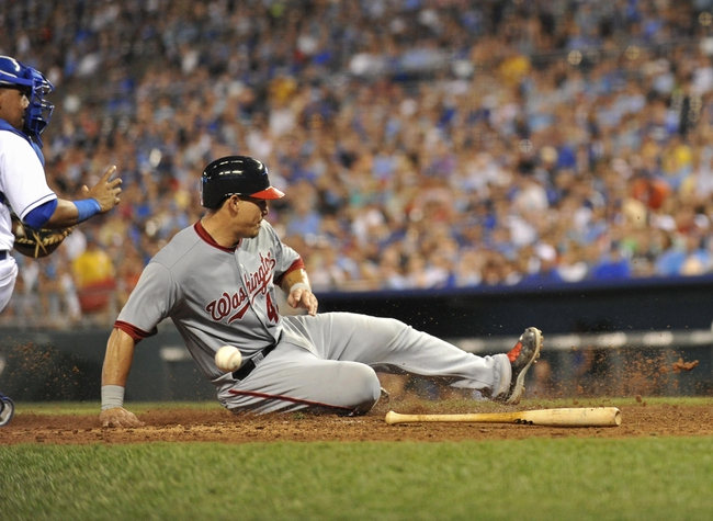 Aug 23, 2013; Kansas City, MO, USA;  Washington Nationals base runner Wilson Ramos (40) scores as he slides home against the Kansas City Royals during the seventh inning at Kauffman Stadium.  Mandatory Credit: Peter G. Aiken-USA TODAY Sports