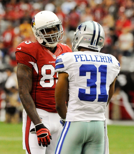 Aug 17, 2013; Phoenix, AZ, USA; Arizona Cardinals wide receiver Dan Buckner (85) and Dallas Cowboys safety Micah Pellerin (31) talk in between plays during the fourth quarter at University of Phoenix Stadium. The Cardinals defeated the Cowboys 12-7. Mandatory Credit: Casey Sapio-USA TODAY Sports