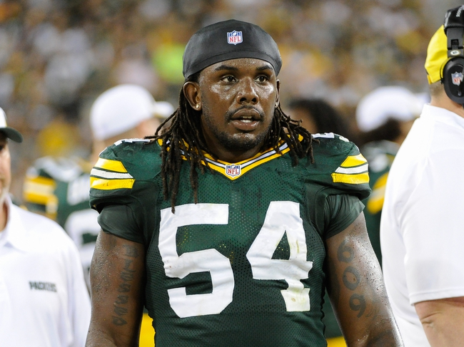 Aug 23, 2013; Green Bay, WI, USA; Green Bay Packers linebacker Dezman Moses (54) during the game against the Seattle Seahawks  at Lambeau Field. Mandatory Credit: Benny Sieu-USA TODAY Sports