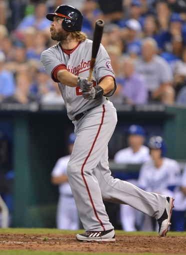 Aug 23, 2013; Kansas City, MO, USA;  Washington Nationals designated hitter Jayson Werth  (28) hits a two-run home run against the Kansas City Royals during the fourth inning at Kauffman Stadium.  Mandatory Credit: Peter G. Aiken-USA TODAY Sports