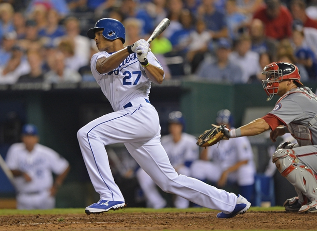 Aug 23, 2013; Kansas City, MO, USA;  Kansas City Royals right fielder Justin Maxwell (27) at bat against the Washington Nationals during the fourth inning at Kauffman Stadium.  Mandatory Credit: Peter G. Aiken-USA TODAY Sports