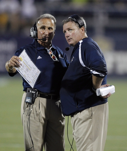 Sept 8 2012; Miami, FL, USA;  Akron Zips special teams coordinator Jeff Bowden (right) talks with associate head coach Chuck Amato in the second quarter at FIU Stadium.  Mandatory Credit: Robert Mayer-USA TODAY Sports