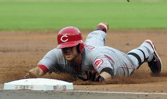 Aug 26, 2013; St. Louis, MO, USA; Cincinnati Reds shortstop Zack Cozart (2) slides safely into third for a two run triple off of St. Louis Cardinals starting pitcher Tyler Lyons (not pictured) during the second inning at Busch Stadium. Mandatory Credit: Jeff Curry-USA TODAY Sports