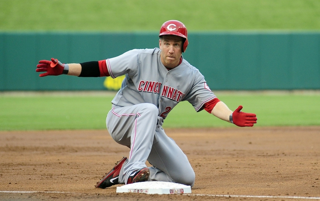 Aug 26, 2013; St. Louis, MO, USA; Cincinnati Reds third baseman Todd Frazier (21) celebrates after hitting a two run triple off of St. Louis Cardinals starting pitcher Tyler Lyons (not pictured) during the second inning at Busch Stadium. Mandatory Credit: Jeff Curry-USA TODAY Sports