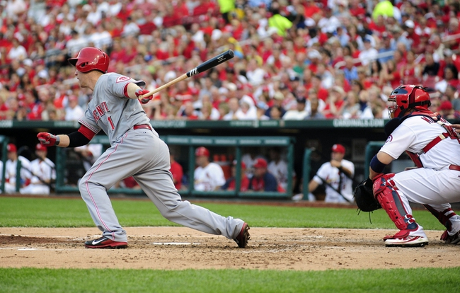 Aug 26, 2013; St. Louis, MO, USA; Cincinnati Reds third baseman Todd Frazier (21) hits a two run triple off of St. Louis Cardinals starting pitcher Tyler Lyons (not pictured) during the second inning at Busch Stadium. Mandatory Credit: Jeff Curry-USA TODAY Sports