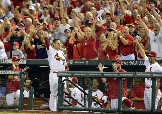 Aug 26, 2013; St. Louis, MO, USA; St. Louis Cardinals first baseman Allen Craig (21) salutes the fans after hitting a grand slam off of Cincinnati Reds relief pitcher J.J. Hoover (not pictured) during the seventh inning at Busch Stadium. St. Louis defeated Cincinnati 8-6. Mandatory Credit: Jeff Curry-USA TODAY Sports