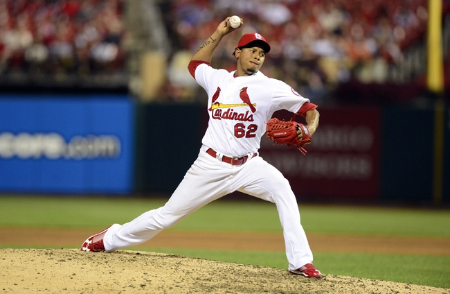 Aug 26, 2013; St. Louis, MO, USA; St. Louis Cardinals relief pitcher Carlos Martinez (62) throws to a Cincinnati Reds batter during the sixth inning at Busch Stadium. Mandatory Credit: Jeff Curry-USA TODAY Sports