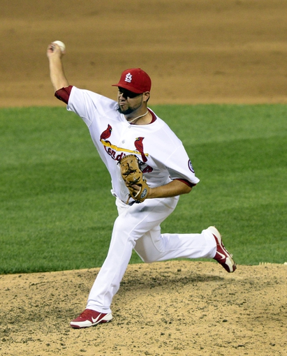Aug 26, 2013; St. Louis, MO, USA; St. Louis Cardinals relief pitcher Edward Mujica (44) throws to a Cincinnati Reds batter during the ninth inning at Busch Stadium. St. Louis defeated Cincinnati 8-6. Mandatory Credit: Jeff Curry-USA TODAY Sports