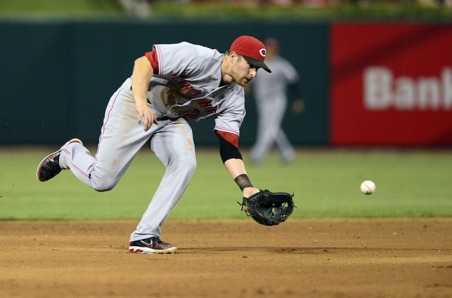 Aug 26, 2013; St. Louis, MO, USA; Cincinnati Reds shortstop Zack Cozart (2) fields and throws out St. Louis Cardinals left fielder Matt Holliday (not pictured) during the sixth inning at Busch Stadium. St. Louis defeated Cincinnati 8-6. Mandatory Credit: Jeff Curry-USA TODAY Sports