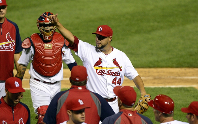 Aug 26, 2013; St. Louis, MO, USA; St. Louis Cardinals relief pitcher Edward Mujica (44) celebrates after closing out the ninth inning against the Cincinnati Reds at Busch Stadium. St. Louis defeated Cincinnati 8-6. Mandatory Credit: Jeff Curry-USA TODAY Sports