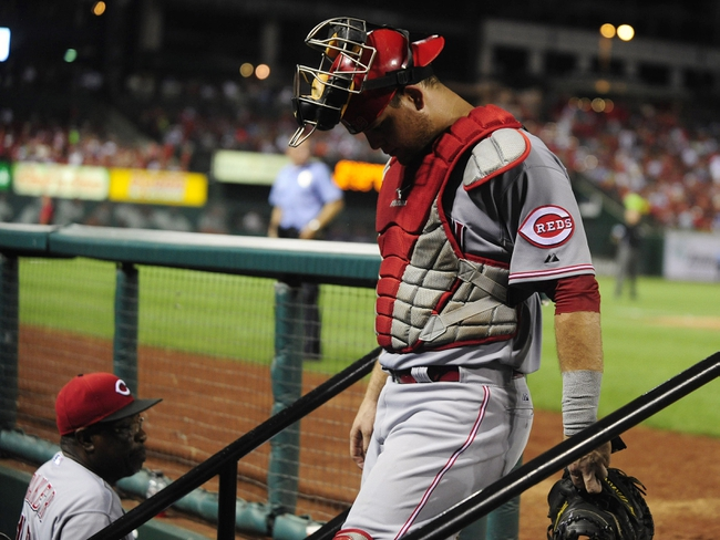 Aug 26, 2013; St. Louis, MO, USA; Cincinnati Reds catcher Devin Mesoraco (39) walks off the field after losing the lead on a grand slam by St. Louis Cardinals first baseman Allen Craig (not pictured) during the seventh inning at Busch Stadium. St. Louis defeated Cincinnati 8-6. Mandatory Credit: Jeff Curry-USA TODAY Sports