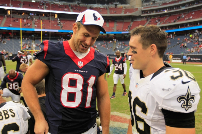 Aug 25, 2013; Houston, TX, USA; Houston Texans tight end Owen Daniels (81) talks to New Orleans Saints free safety Jim Leonhard (36) after the game at Reliant Stadium. The Saints won 31-23. Mandatory Credit: Thomas Campbell-USA TODAY Sports