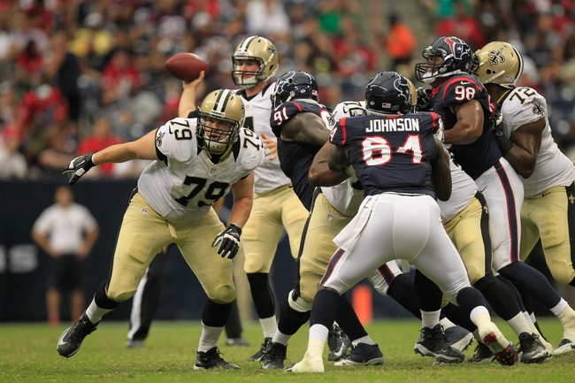 Aug 25, 2013; Houston, TX, USA; New Orleans Saints tackle Bryce Harris (79) blocks against the Houston Texans during the second half at Reliant Stadium. The Saints won 31-23. Mandatory Credit: Thomas Campbell-USA TODAY Sports