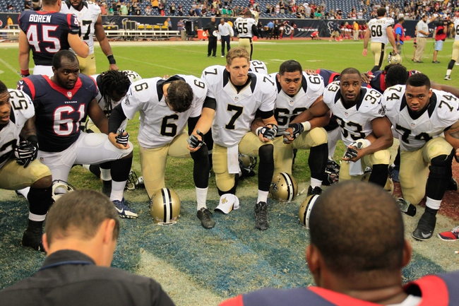 Aug 25, 2013; Houston, TX, USA; Members of the New Orleans Saints and Houston Texans pray after the game at Reliant Stadium. The Saints won 31-23. Mandatory Credit: Thomas Campbell-USA TODAY Sports