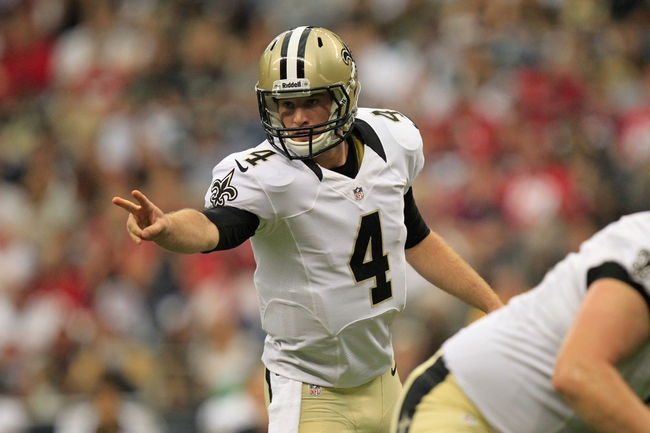 Aug 25, 2013; Houston, TX, USA; New Orleans Saints quarterback Ryan Griffin (4) calls a play against the Houston Texans during the second half at Reliant Stadium. The Saints won 31-23. Mandatory Credit: Thomas Campbell-USA TODAY Sports