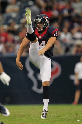 Aug 25, 2013; Houston, TX, USA; Houston Texans punter Andrew Shapiro (14) punts against the New Orleans Saints during the second half at Reliant Stadium. The Saints won 31-23. Mandatory Credit: Thomas Campbell-USA TODAY Sports