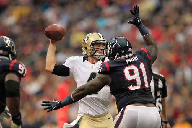 Aug 25, 2013; Houston, TX, USA; New Orleans Saints quarterback Ryan Griffin (4) passes as Houston Texans defensive tackle Daniel Muir (91) rushes during the second half at Reliant Stadium. The Saints won 31-23. Mandatory Credit: Thomas Campbell-USA TODAY Sports