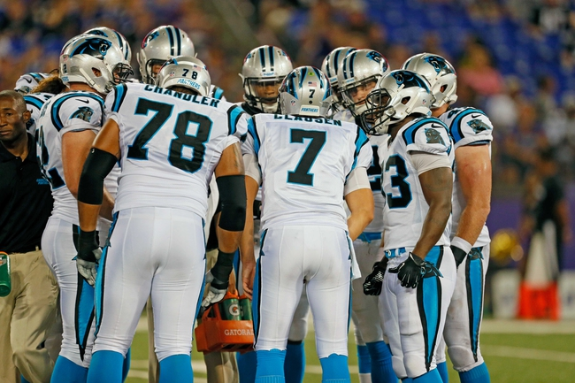 Aug 22, 2013; Baltimore, MD, USA; Carolina Panthers quarterback Jimmy Clausen (7) leads the offensive huddle against the Baltimore Ravens at M&T Bank Stadium. Mandatory Credit: Mitch Stringer-USA TODAY Sports