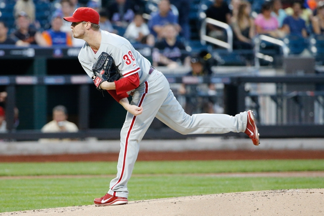 Aug 27, 2013; New York, NY, USA;  Philadelphia Phillies starting pitcher Kyle Kendrick (38) pitches during the first inning against the New York Mets at Citi Field. Mandatory Credit: Anthony Gruppuso-USA TODAY Sports
