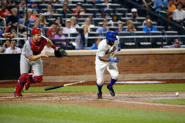 Aug 27, 2013; New York, NY, USA;  New York Mets left fielder Eric Young Jr. (22) sacrifices to Philadelphia Phillies catcher Erik Kratz (31) during the third inning at Citi Field. Mandatory Credit: Anthony Gruppuso-USA TODAY Sports