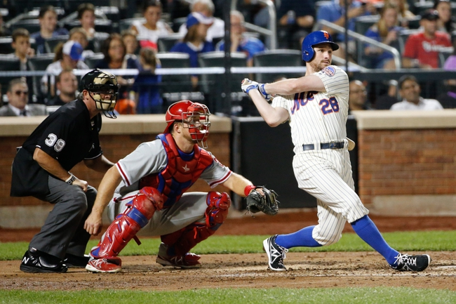 Aug 27, 2013; New York, NY, USA;  New York Mets second baseman Daniel Murphy (28) singles to right allowing a runner to score during the third inning against the Philadelphia Phillies at Citi Field. Mandatory Credit: Anthony Gruppuso-USA TODAY Sports