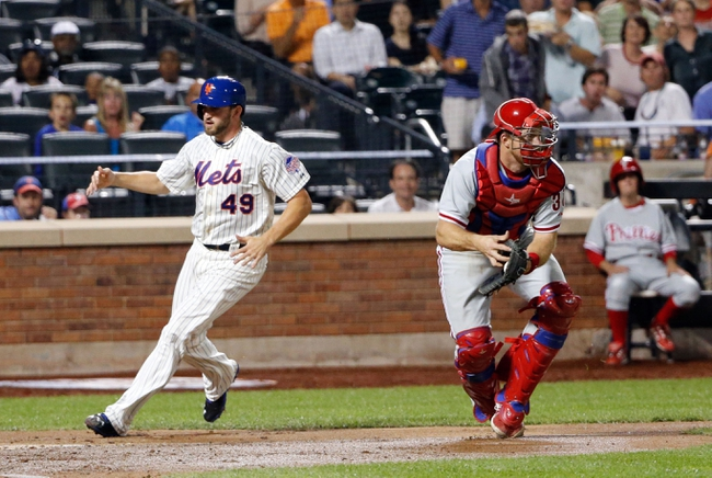 Aug 27, 2013; New York, NY, USA;  New York Mets starting pitcher Jonathon Niese (49) scores as Philadelphia Phillies catcher Erik Kratz (31) readies throws to second during the third inning at Citi Field. Mandatory Credit: Anthony Gruppuso-USA TODAY Sports