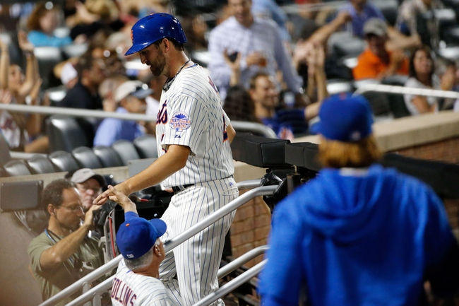Aug 27, 2013; New York, NY, USA;  New York Mets manager Terry Collins (10) high fives starting pitcher Jonathon Niese (49) on scoring during the third inning against the Philadelphia Phillies at Citi Field. Mandatory Credit: Anthony Gruppuso-USA TODAY Sports