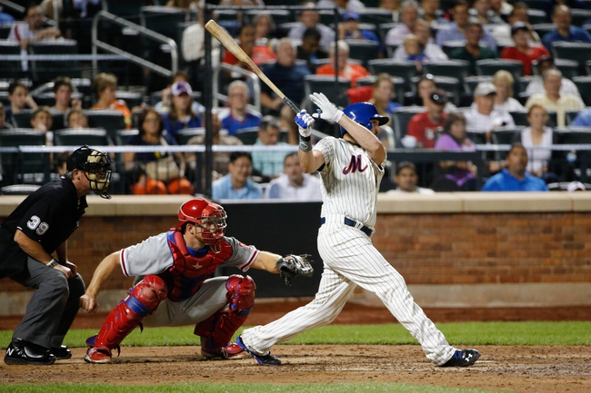 Aug 27, 2013; New York, NY, USA;  New York Mets starting pitcher Jonathon Niese (49) doubles to center allowing two runners to score during the sixth inning at Citi Field. Mandatory Credit: Anthony Gruppuso-USA TODAY Sports