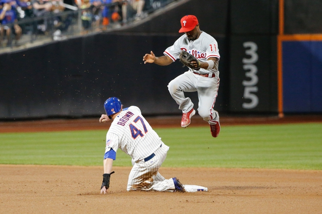 Aug 27, 2013; New York, NY, USA;  New York Mets left fielder Andrew Brown (47) slides past Philadelphia Phillies shortstop Jimmy Rollins (11) at second on a throwing error to advance to third during the sixth inning at Citi Field. Mandatory Credit: Anthony Gruppuso-USA TODAY Sports