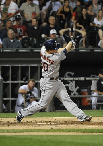 Aug 27, 2013; Chicago, IL, USA; Houston Astros third baseman Matt Dominguez (30) hits an RBI single against the Chicago White Sox during the fourth inning at U.S. Cellular Field. Mandatory Credit: David Banks-USA TODAY Sports