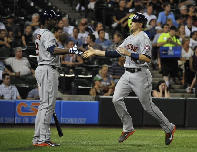 Aug 27, 2013; Chicago, IL, USA; Houston Astros catcher Jason Castro (15) is greeted by  designated hitter  Chris Carter (23) after scoring against the Chicago White Sox during the fourth inning at U.S. Cellular Field. Mandatory Credit: David Banks-USA TODAY Sports