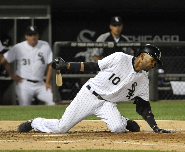 Aug 27, 2013; Chicago, IL, USA; Chicago White Sox shortstop Alexei Ramirez (10) gets out of the way of a pitch against the Houston Astros during the fourth inning at U.S. Cellular Field. Mandatory Credit: David Banks-USA TODAY Sports