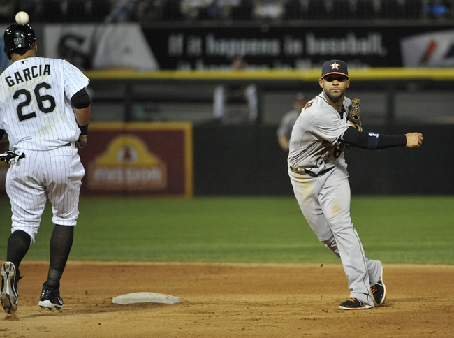 Aug 27, 2013; Chicago, IL, USA;  Houston Astros shortstop Jonathan Villar (6) forces out Chicago White Sox right fielder Avisail Garcia (26) then throws to first to compete the double play during the fourth inning at U.S. Cellular Field. Mandatory Credit: David Banks-USA TODAY Sports