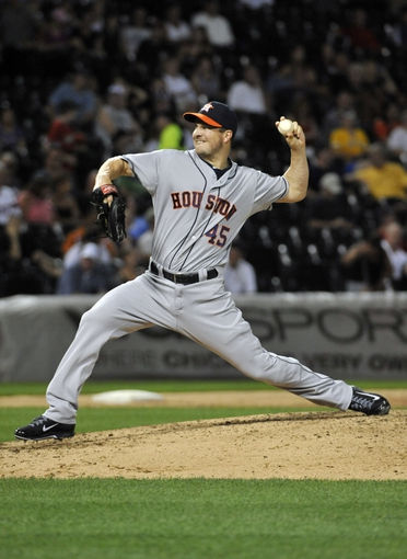Aug 27, 2013; Chicago, IL, USA; Houston Astros relief pitcher Erik Bedard (45) pitches against the Chicago White Sox during the sixth inning at U.S. Cellular Field. The Chicago White Sox defeated the Houston Astros 4-3. Mandatory Credit: David Banks-USA TODAY Sports