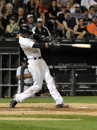 Aug 27, 2013; Chicago, IL, USA; Chicago White Sox shortstop Alexei Ramirez (10) hits a double against the Houston Astros during the sixth inning at U.S. Cellular Field. The Chicago White Sox defeated the Houston Astros 4-3. Mandatory Credit: David Banks-USA TODAY Sports