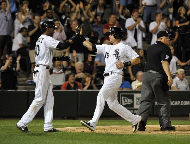 Aug 27, 2013; Chicago, IL, USA; Chicago White Sox second baseman Gordon Beckham (15) is greeted by shortstop Alexei Ramirez (10) after they both scored against the Houston Astros during the eighth inning at U.S. Cellular Field. The Chicago White Sox defeated the Houston Astros 4-3. Mandatory Credit: David Banks-USA TODAY Sports