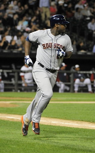 Aug 28, 2013; Chicago, IL, USA; Houston Astros first baseman Chris Carter (23) runs the bases after hitting a home run against the Chicago White Sox during the seventh inning at U.S. Cellular Field.  Mandatory Credit: David Banks-USA TODAY Sports