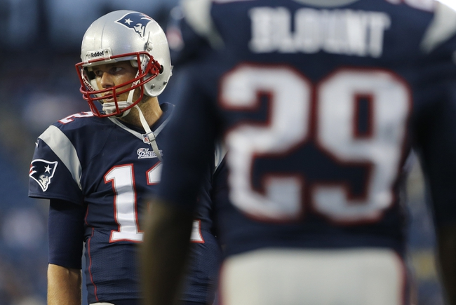 Aug 29, 2013; Foxborough, MA, USA; New England Patriots quarterback Tom Brady (12) warms up before the start of the game against the New York Giants at Gillette Stadium. Mandatory Credit: David Butler II-USA TODAY Sports