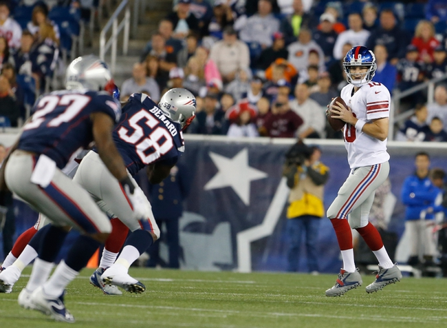 Aug 29, 2013; Foxborough, MA, USA; New York Giants quarterback Eli Manning (10) looks to pass against the New England Patriots in the first quarter at Gillette Stadium. Mandatory Credit: David Butler II-USA TODAY Sports