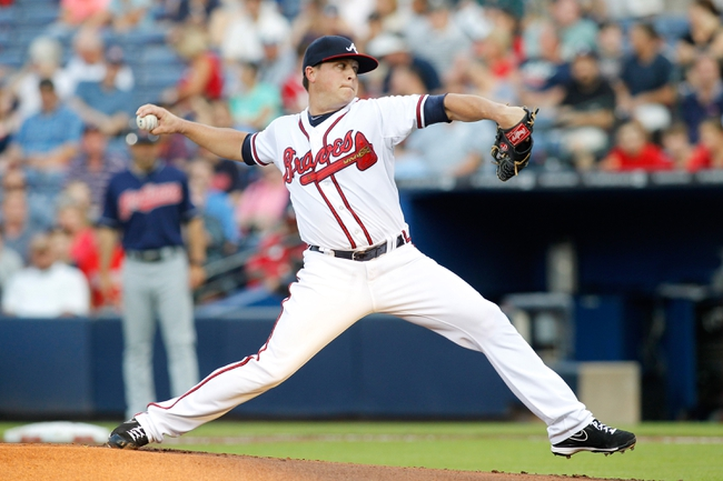 Aug 29, 2013; Atlanta, GA, USA; Atlanta Braves starting pitcher Kris Medlen (54) throws a pitch against the Cleveland Indians in the first inning at Turner Field. Mandatory Credit: Brett Davis-USA TODAY Sports